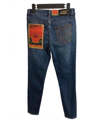 Джинсы с вышивкой на кармане 19396